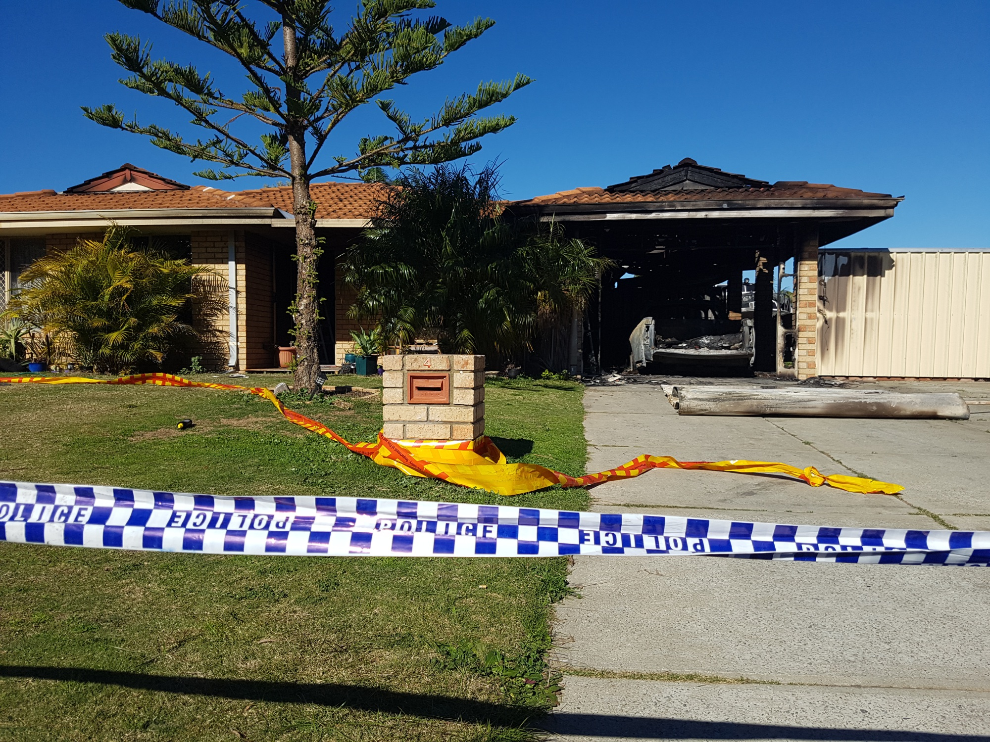 The fire is believed to have begun in the carport of the Cooloongup home.