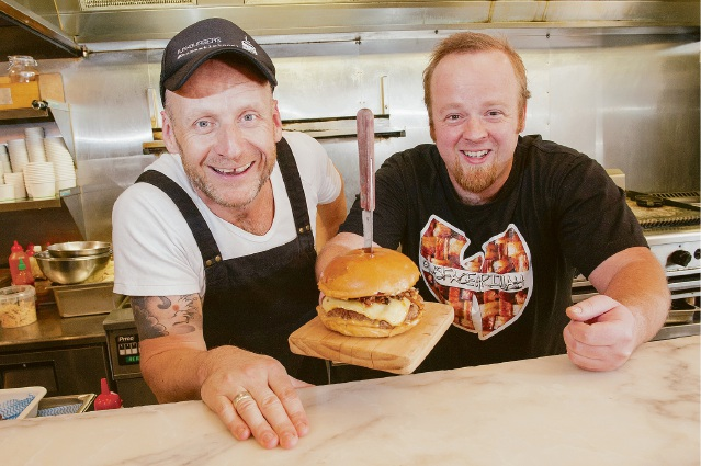 Gus Gallagher, of Belmont, (right) with Justin Bell of Jus Burgers.