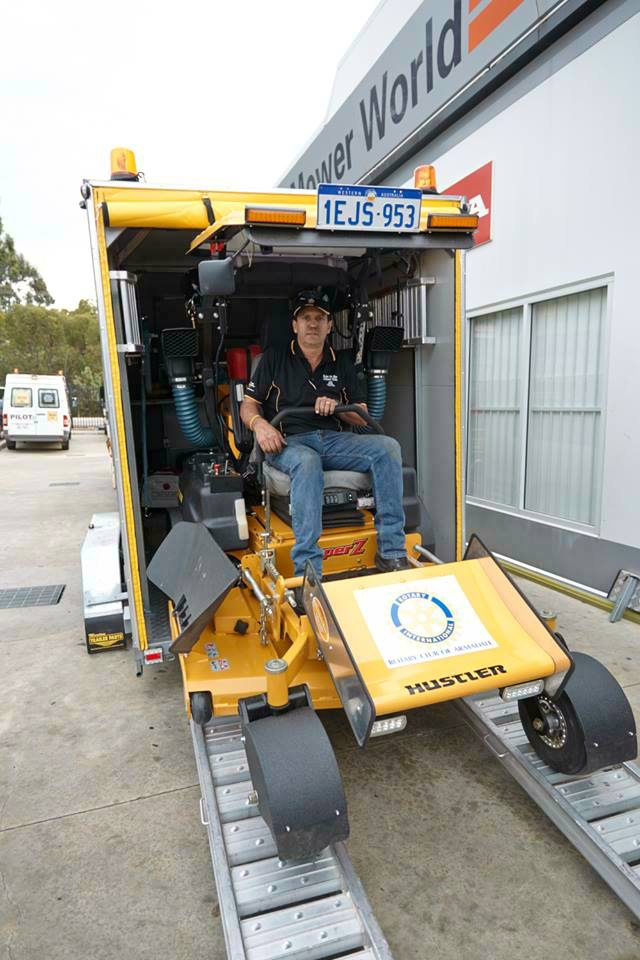 Craig Alford loads his mower into a specially made trailer ready for the trip to Katherine.