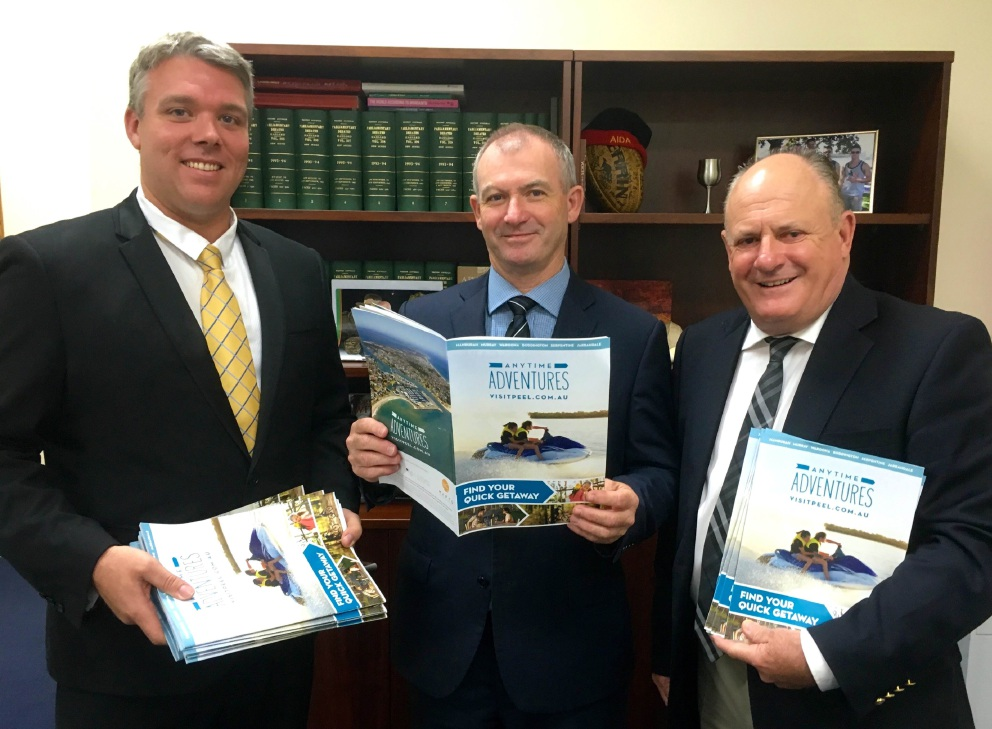 Tourism Minister Kim Hames MLA, Leighton Yates and Paul Fitzpatrick reviewing copies of the new guide.