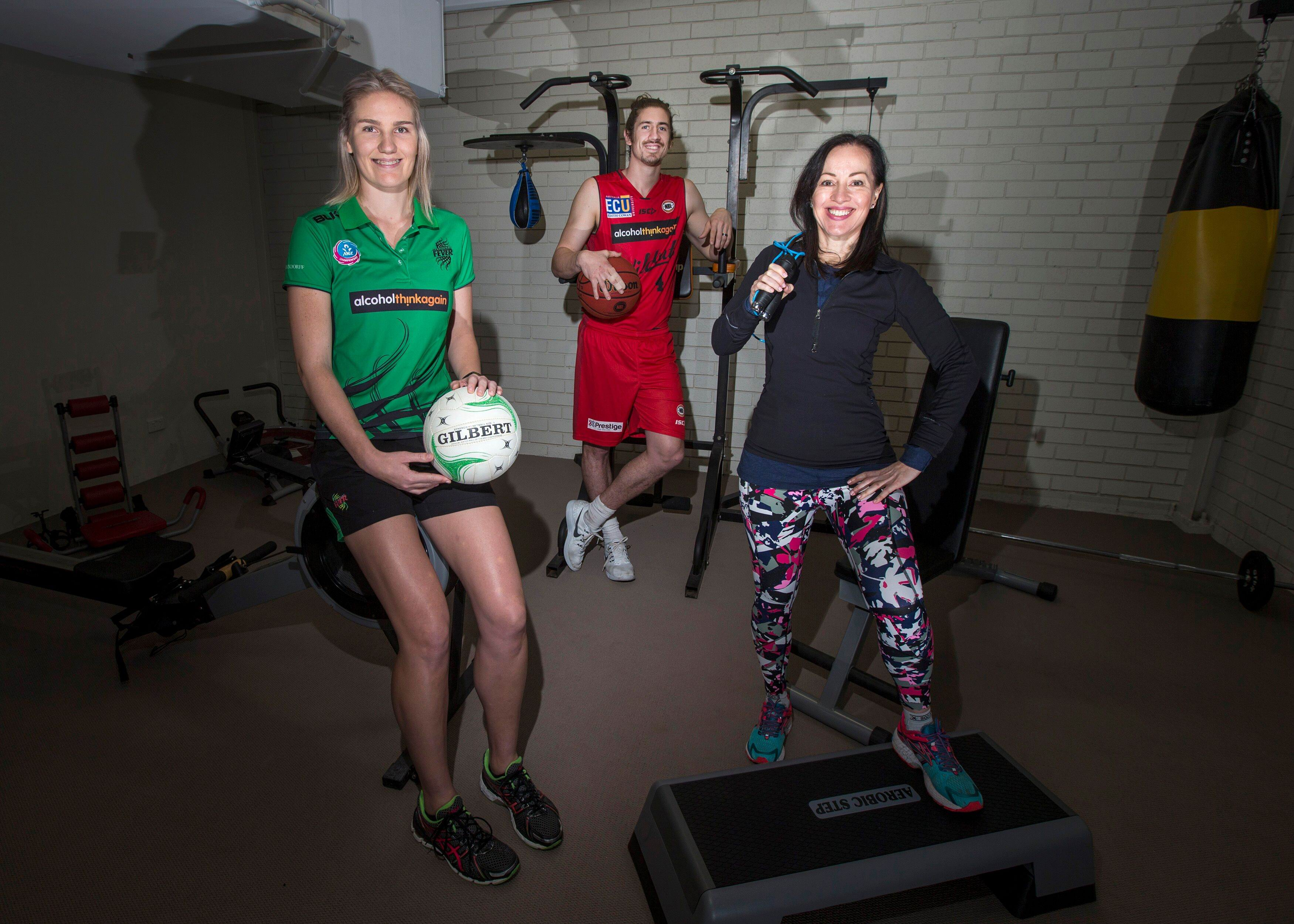 Youth Focus Ambassadors West Coast Fever star Courtney Bruce (left) and Perth Wildcats vice-captain Greg Hire with Youth Focus CEO Fiona Kalaf.