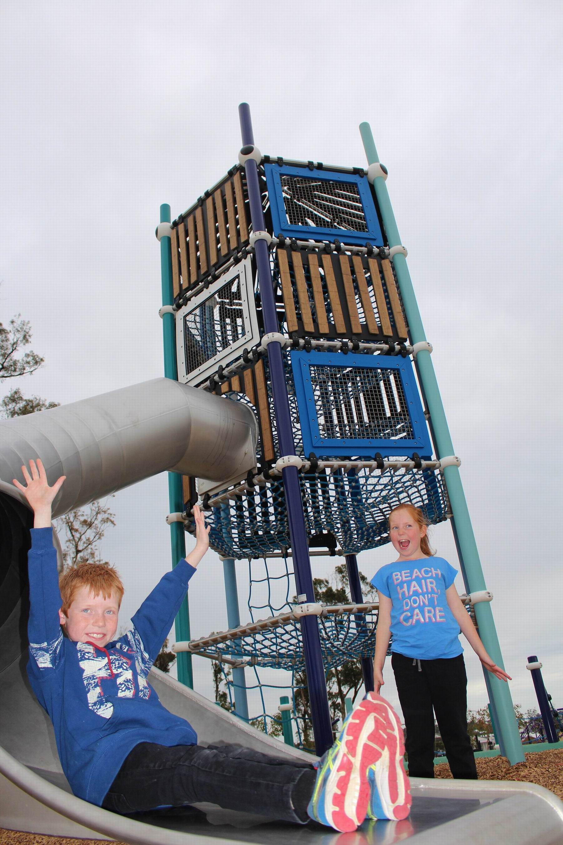 Mia and Aidan Rootman (9) playing on the tower and tunnel slide.