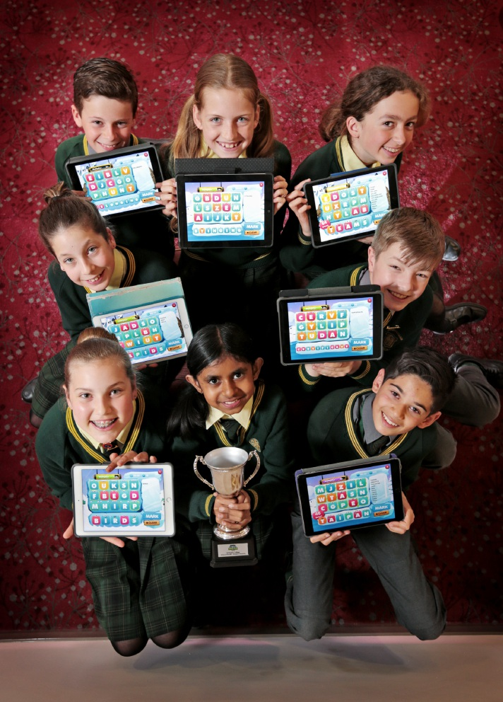 Student Ewny Bellana (front, centre) holds the trophy the school won in 2015, with, clockwise, Rachel Whittington, Lauren Tindall, Luke Sayer, Chelsea Willock, Scarlett Cross, Flynn Throssell and Sachin Albuquerque. Picture: David Baylis www.communitypix.com.au  d457730