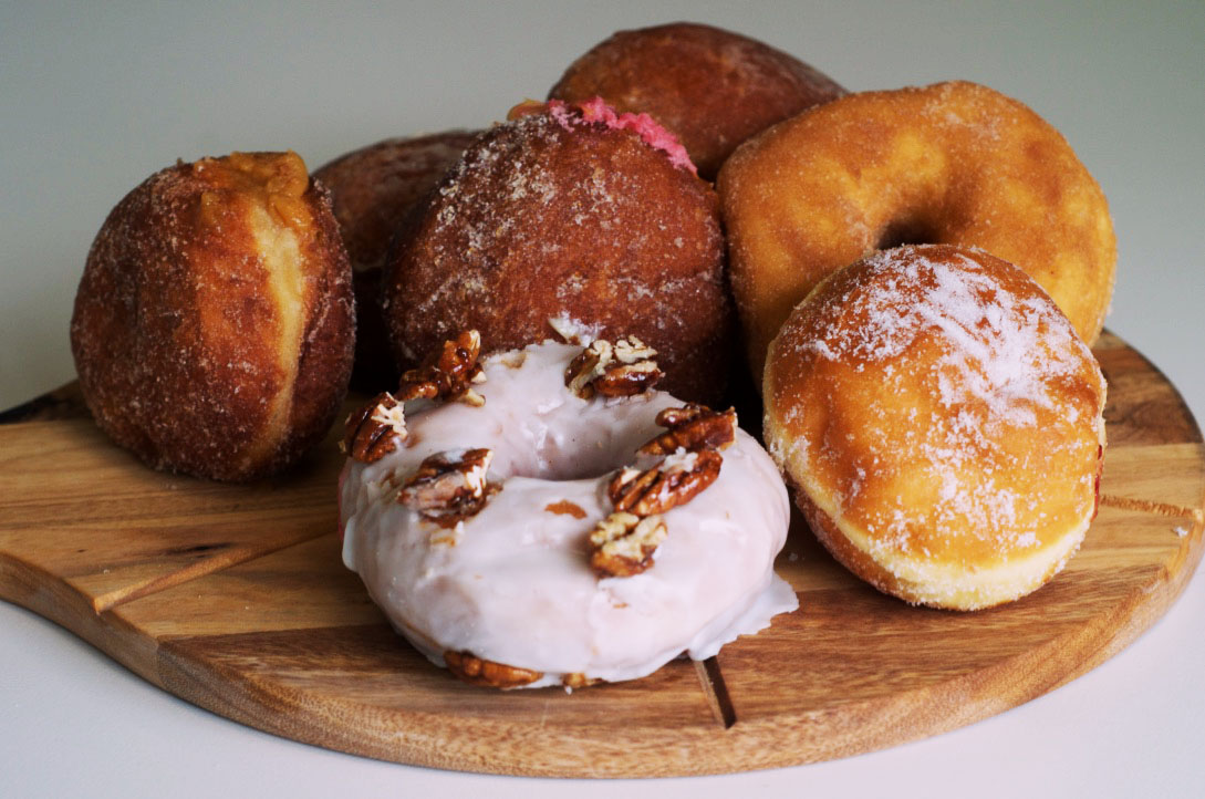Mary St Bakery's salted caramel (left) and maple pecan (front) doughnuts are the best Perth has to offer.  Picture: Kathy Ociepa.