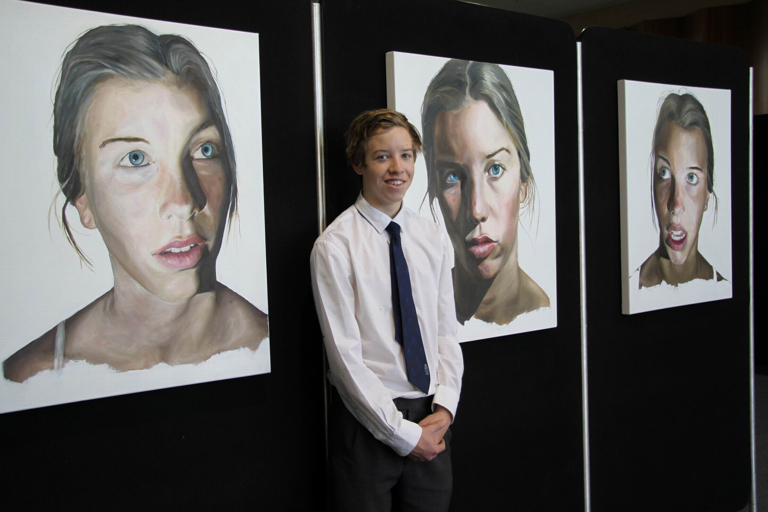 Jared Hill with his portrait.