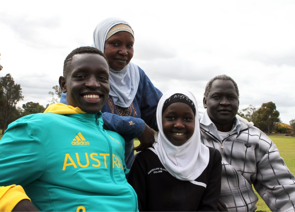 Peter Bol with his mum Hanan Kuku, sister Nyibll Bol and dad Abdalla Bol.  Picture: Robin Kornet        www.communitypix.com.au   d458906