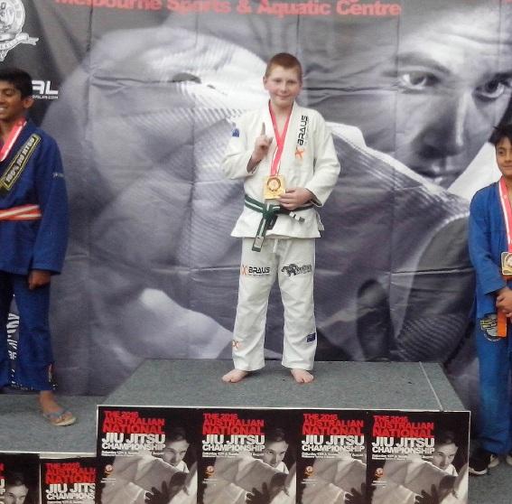 Alex Nicholls with his jiu-jitsu awards.