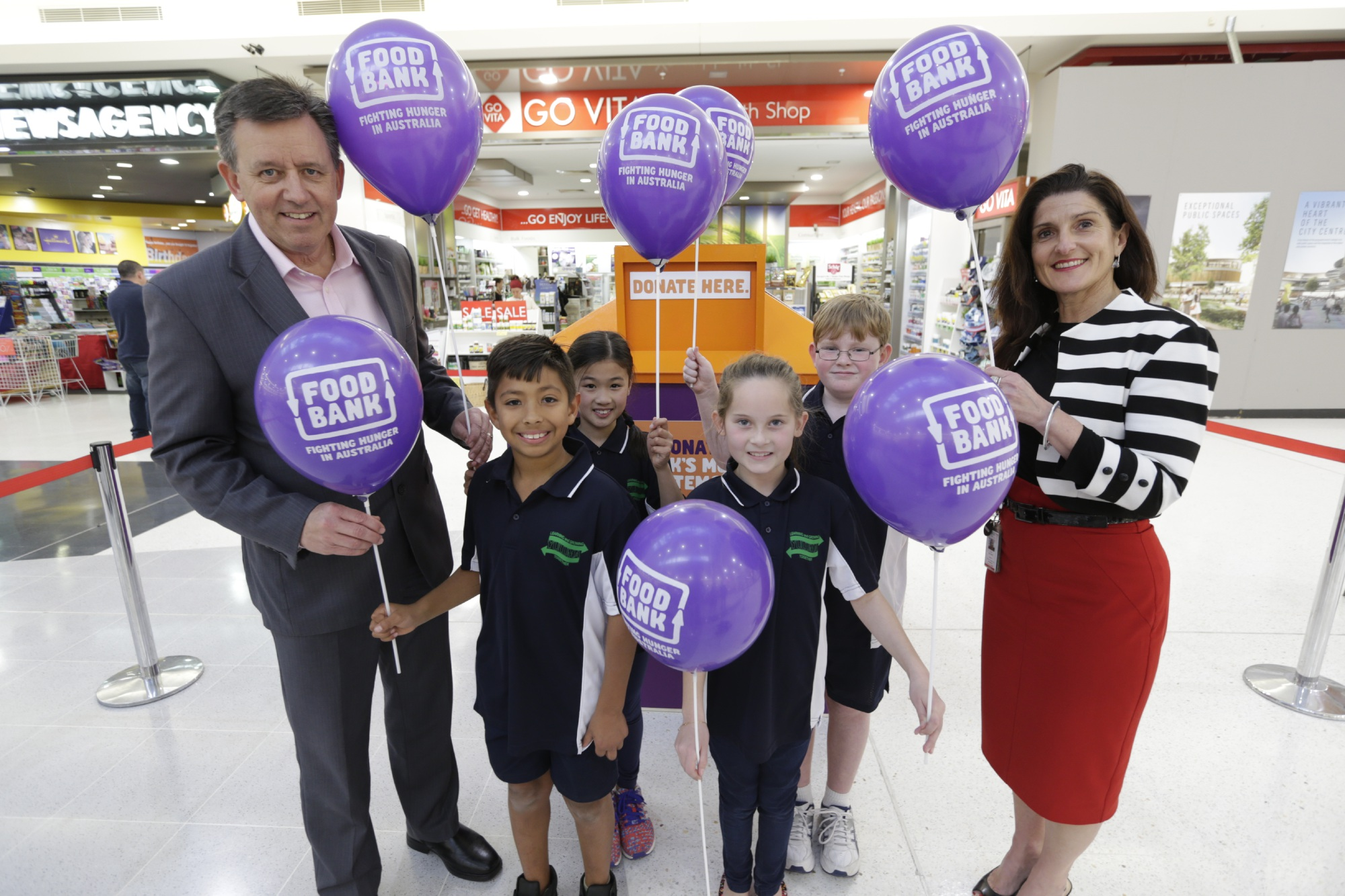 Foodbank WA CEO Greg Hebble with Yuluma Primary School students Amar Marmanillo (Year 4), Janelle Ong (Year 5), Ella Manning (Year 4) and Mark Van Derdetten (Year 5). Westfield Innaloo centre manager Mary Del Dosso is on the right. Picture: Andrew Ritchie.