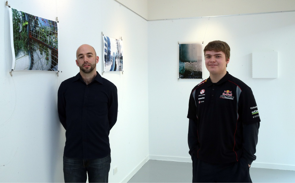 Program co-ordinator Mark Bird with young photographer Lewis Butler. Picture: Martin Kennealey    d459088
