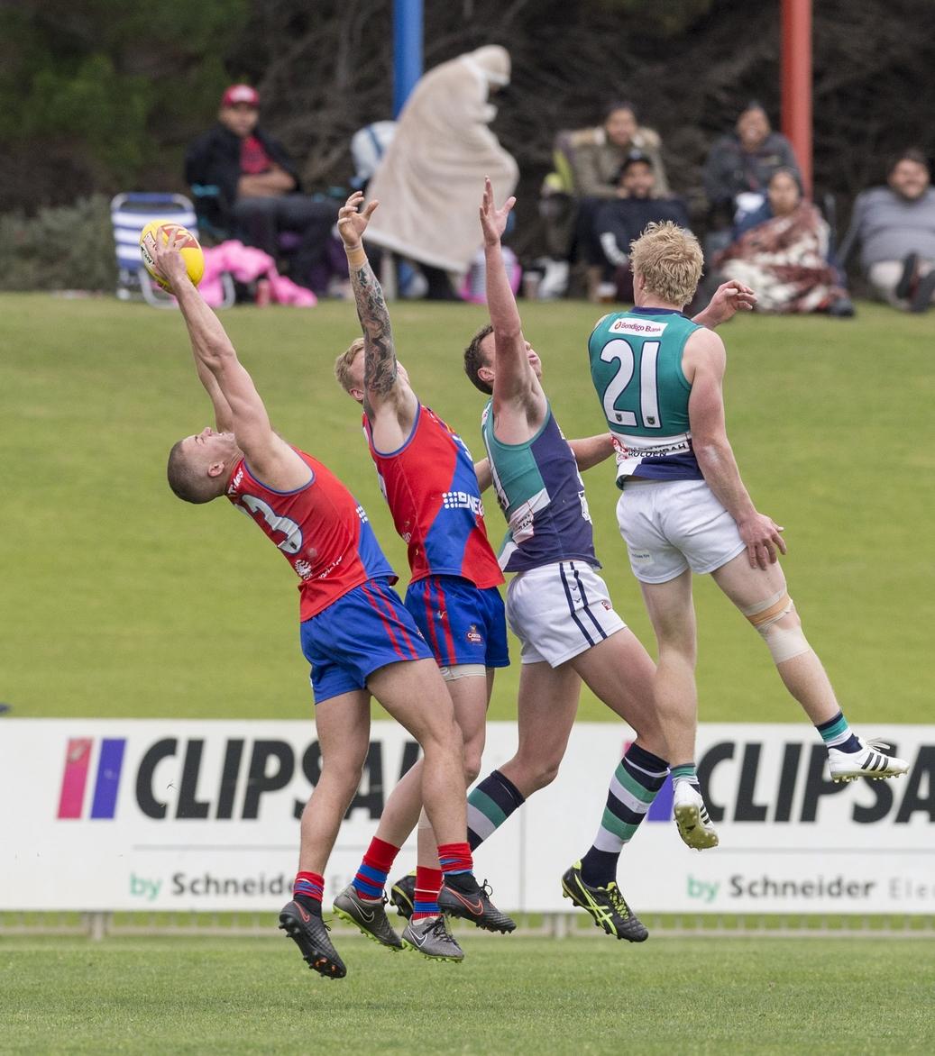Luke Meadows takes a mark fourth in line. Picture: Dan White
