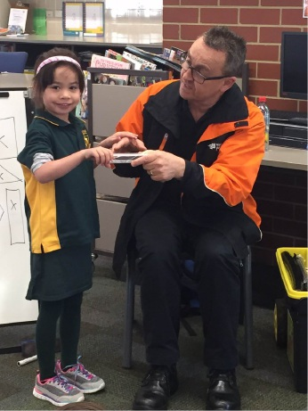 Terry Soutar from Western Power talks to student Caitlyn Donohoe about electrical circuits.