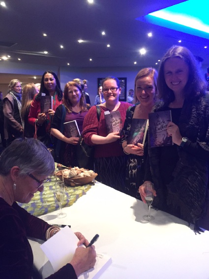 Dianne Wolfer signs copies of her book The Shark Caller at a launch at AQWA. Picture: Frane Lessac