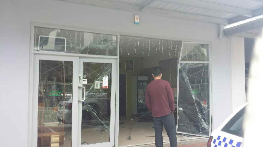 The front of the restaurant was damaged after an elderly man drove through the entrance. Picture: Gabrielle Jeffrey