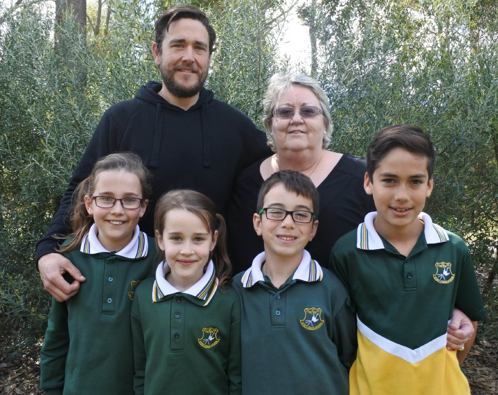 St Vincent's School education assistant Helen Iriks with three generations who attended the school: Adam Iriks and students Kaylee Iriks, Abbey Iriks, Levi Da Silva and Noah Da Silva.
