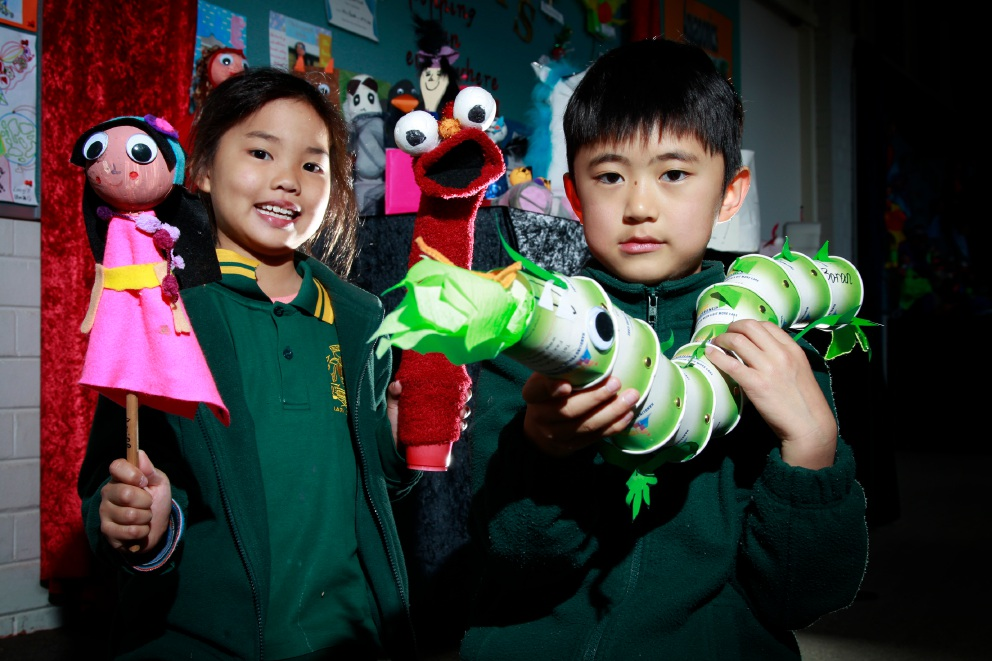 Best puppet winner Boran Yang (7) and                           3rd place Aimee Chen (8) with her puppet Selistia.