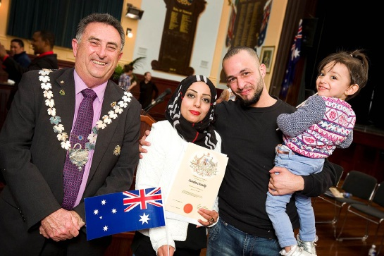 Mayor Mick Wainwright welcomes new citizens Sarah Beni-ezz, Waeel Ibrahim and Rawan Ibrahim.