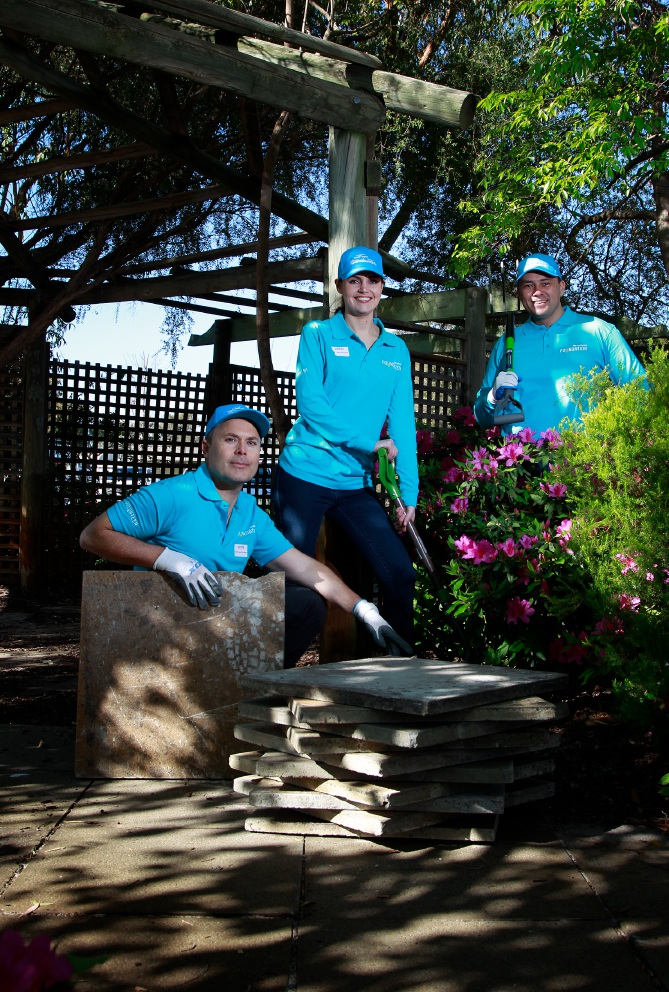 Lendlease marketing manager Samantha Simpson with Lendlease volunteers Quentin Dennis (left) and Brad Toko-Layton who are giving the school garden a lift. Picture: Marie Nirme