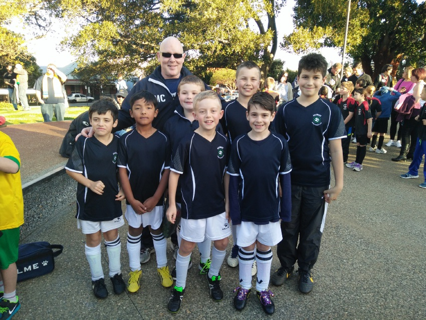 Above: Belmont Junior Soccer Club president Martin Connolly has been amazed at the growth of the club this year. Right: Belmont Junior Soccer Club players prepare to play during half-time at the World Cup qualifying game between Australia and Iraq. Main picture: Marie Nirme www.communitypix.com.au   d459462
