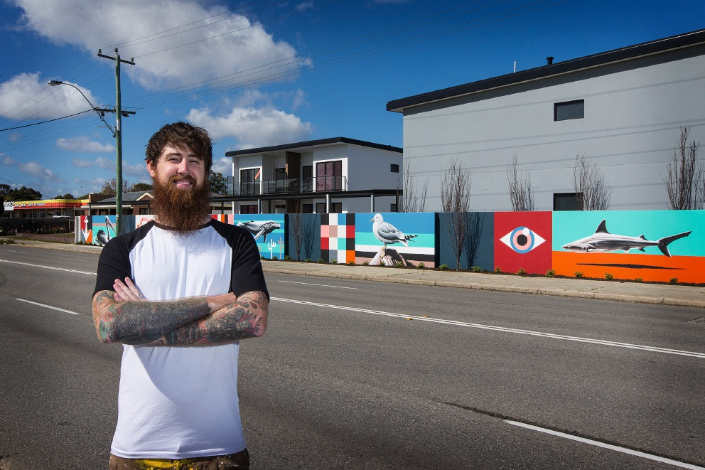 Brenton See in front of his mural. Picture: Will Russell        www.communitypix.com.au   d459616