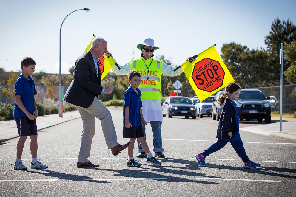 Kade Ritchie, Cockburn MLA Fran Logan, Mace Ritchie and Evelyn Rebola with the new traffic warden. Picture: Will Russell        d459571