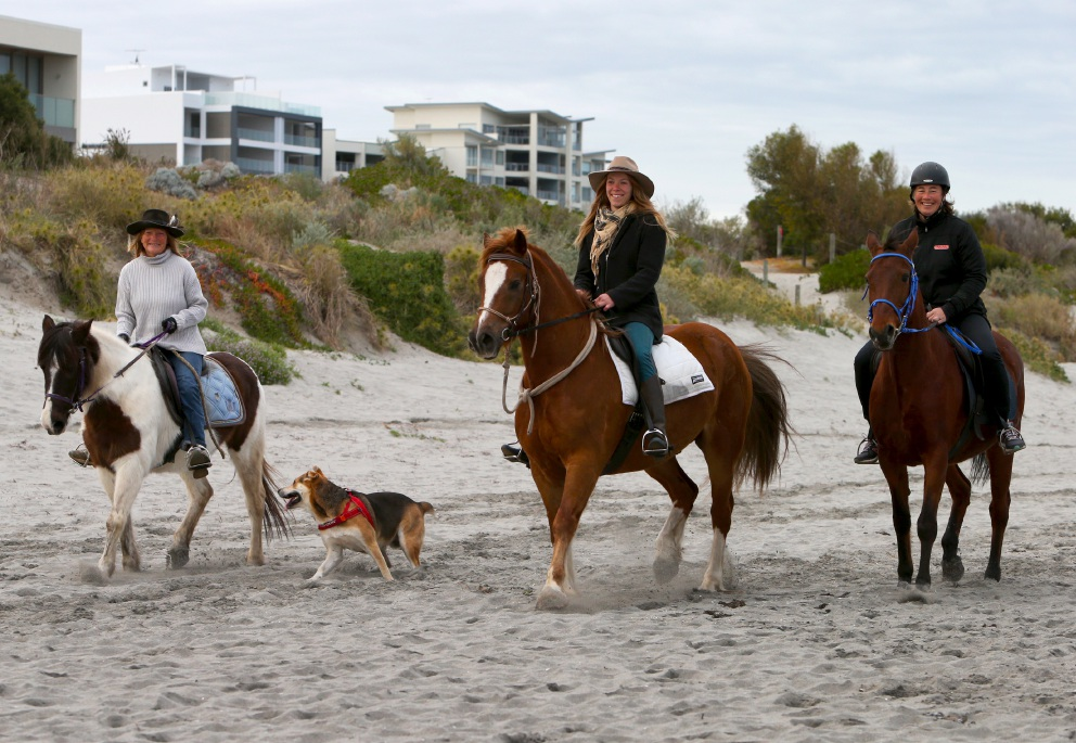 Alison Bolas, Jasmin Sutcliffe and Annette Drenth take their horses for a run on the beach. Picture: Matt Jelonek        www.communitypix.com.au   d457672