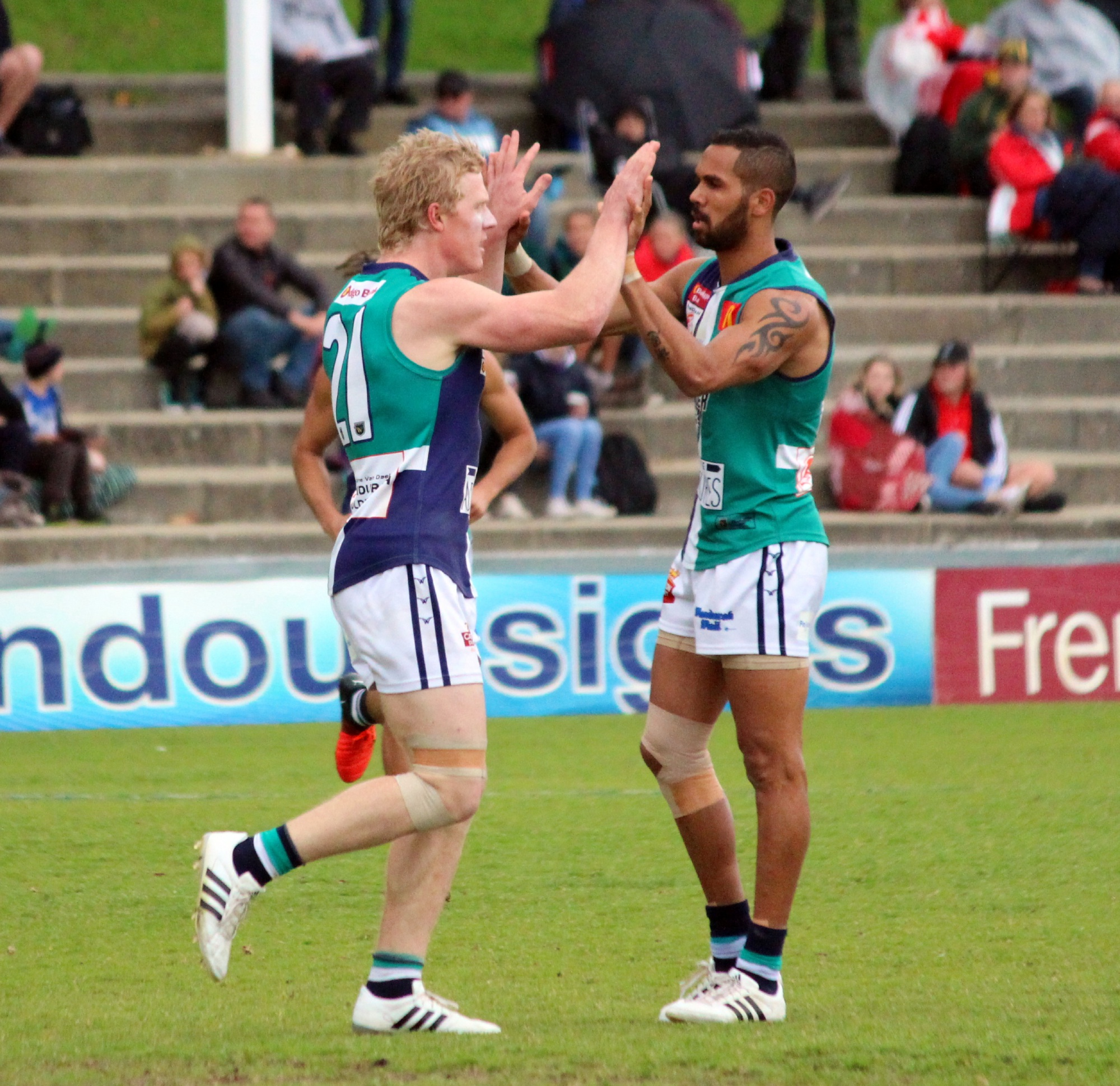 Blair Bell celebrates a goal against South Fremantle with teammate Shane Yarran.