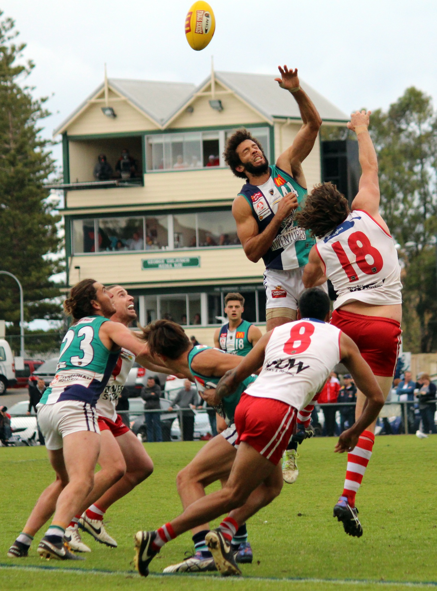 Zac Clarke flies high above the pack during Peel Thunder's finals match against South Fremantle on Sunday. Picture: Declan Byrne