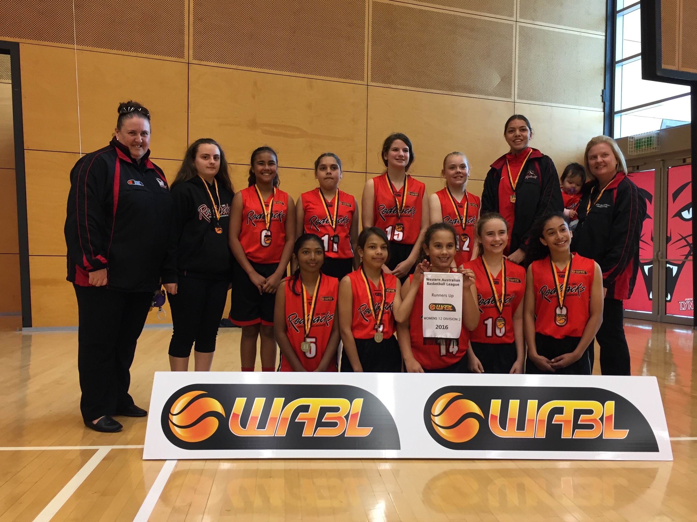 The Perth Redbacks under-12 2 girls team pushed the Rockingham Flames but ultimately fell 65-53.