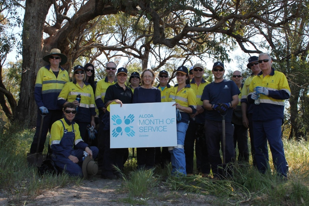 Riding for the Disabled WA Mead Farm Coordinator Kristin Hosken (centre) with volunteers from Alcoa's Huntly Mine.