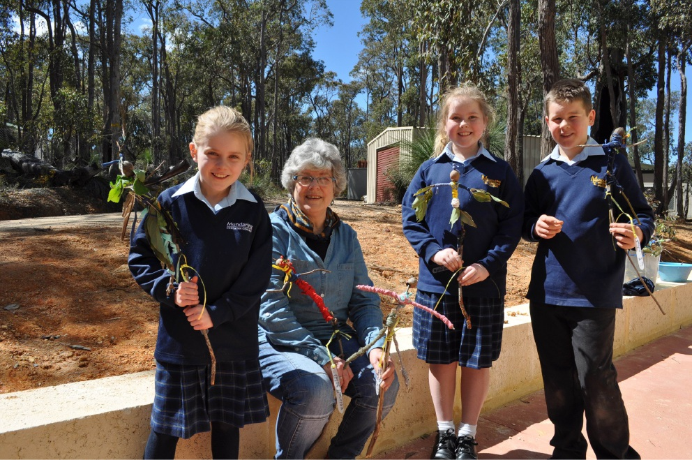 Mundaring Christian College students Laila Jenkins, Emily Colley and Austin Johnson with artist Anne Williams and the displays at Trek the Trail.