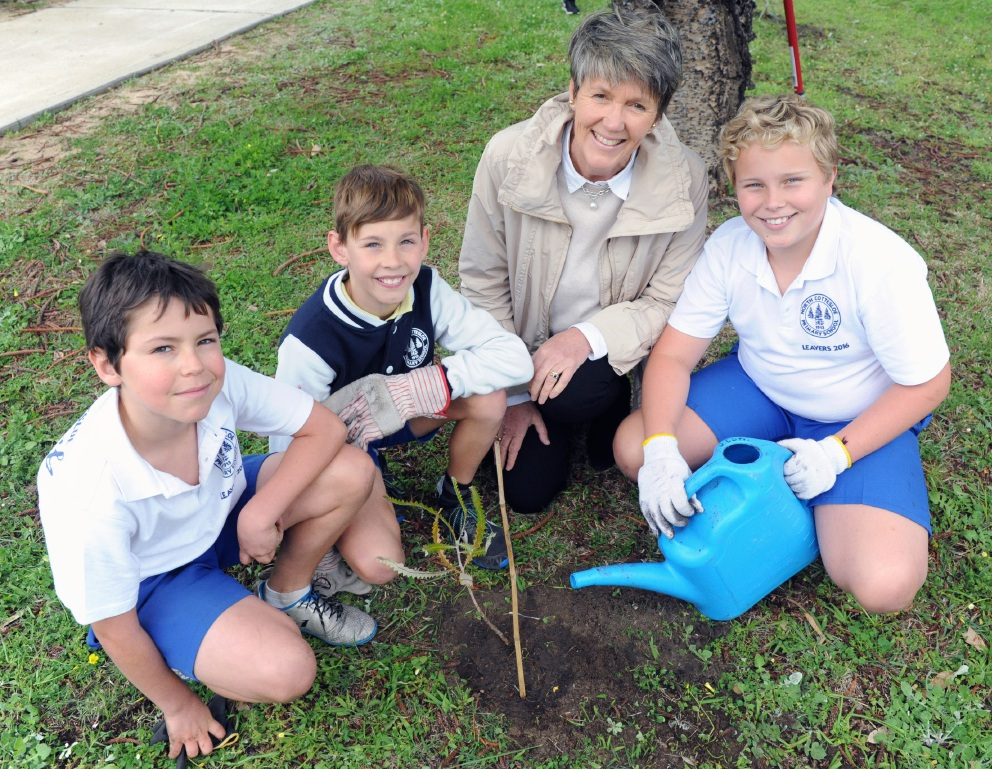Planting trees with Mayor Jo Dawkins were 11-year-old North Cottesloe Primary School students Oliver Morris, Taylor Kappler and Oscar Palandri.