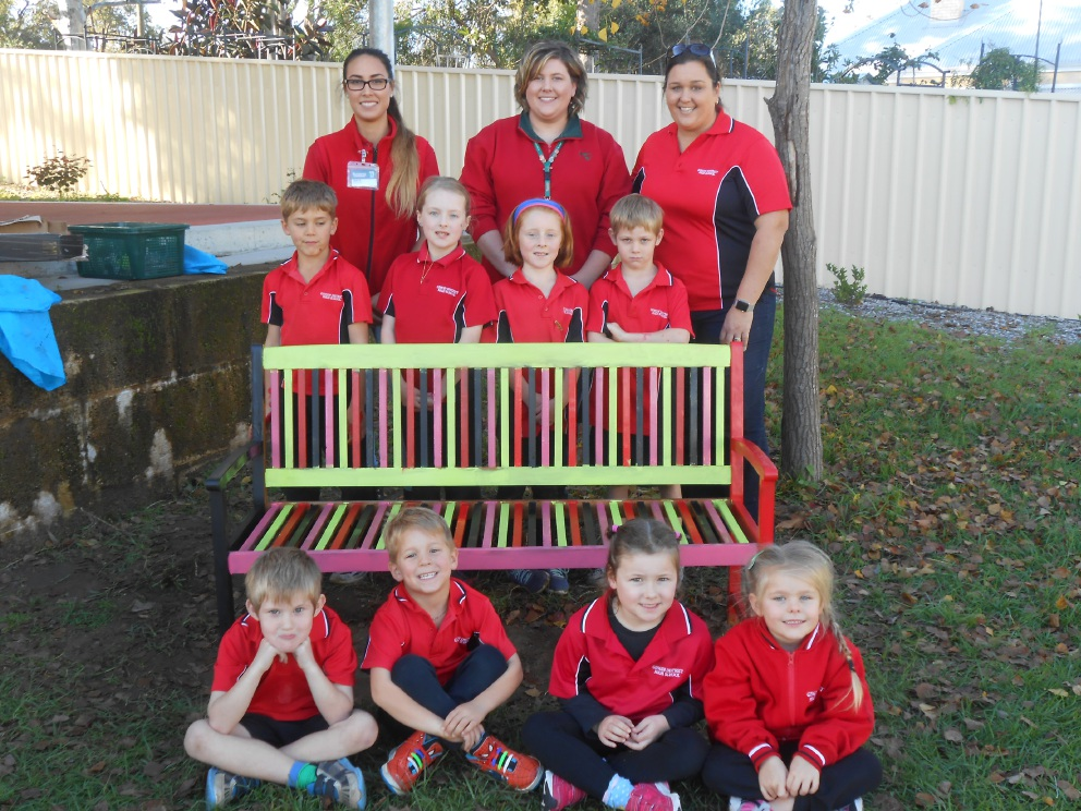 Students from Gingin District High School enjoying the new Buddy Bench.