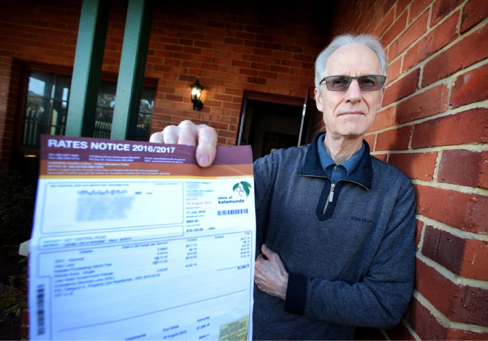 Mr Roger Jennings from Kalamunda is concerned about the $15 charge on his rates notice for processing the government rebate. Picture: David Baylis.