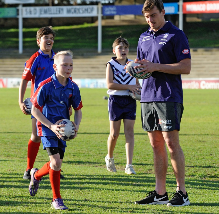 Nick Suban running through a clinic with local footballers.