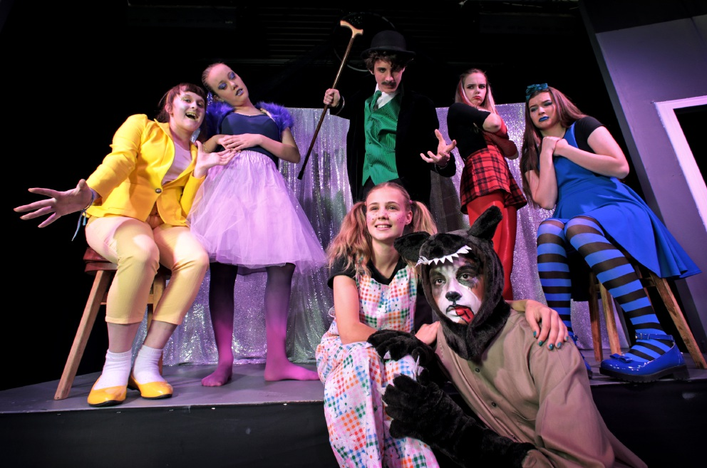 Olivia Doherty (15) as Happy, Hayley Forrest (14) as Lazy, Joshua Martin (16) as Mr A, Sarah Sinclair (14) as Arrogant and Tanya Doogan (16) as Sad. In the front row are Skylah May (16) as Suzy and Julian Rowles (14) as Neville.