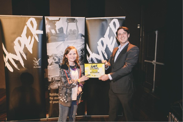 Hayley Kerr is handed her winning award from the Cr Mark Elliott at Midland Gate Hypervision. Picture: Supplied.