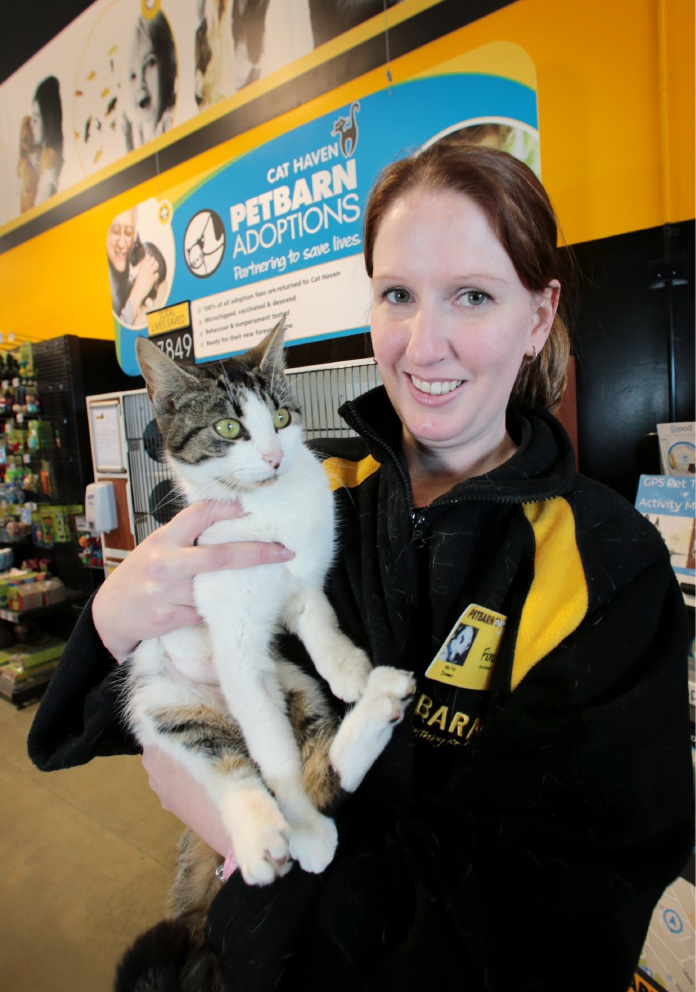 Store manager Fiona Middleton with Emery the cat who is a domestic short hair with white paws and chest and is very friendly and only 1.5 years old. Picture: David Baylis