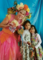 Fairy Sandie with Nikki (4) and Vicki (3) Aung. Picture: Martin Kennealey