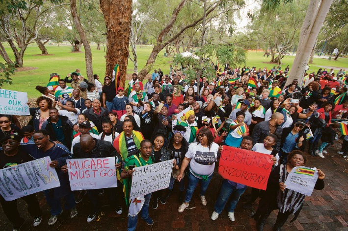 About 300 people attended a #thisflag gathering in Perth calling for political change in Zimbabwe. Pictures: Jarvis Eyes