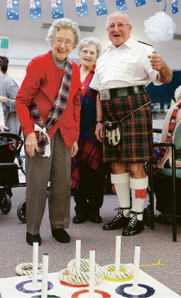 Braemar Village residents Margaret Creer and Pearl Corcoran, with Pearl's son and bagpiper for the day William Corcaran.
