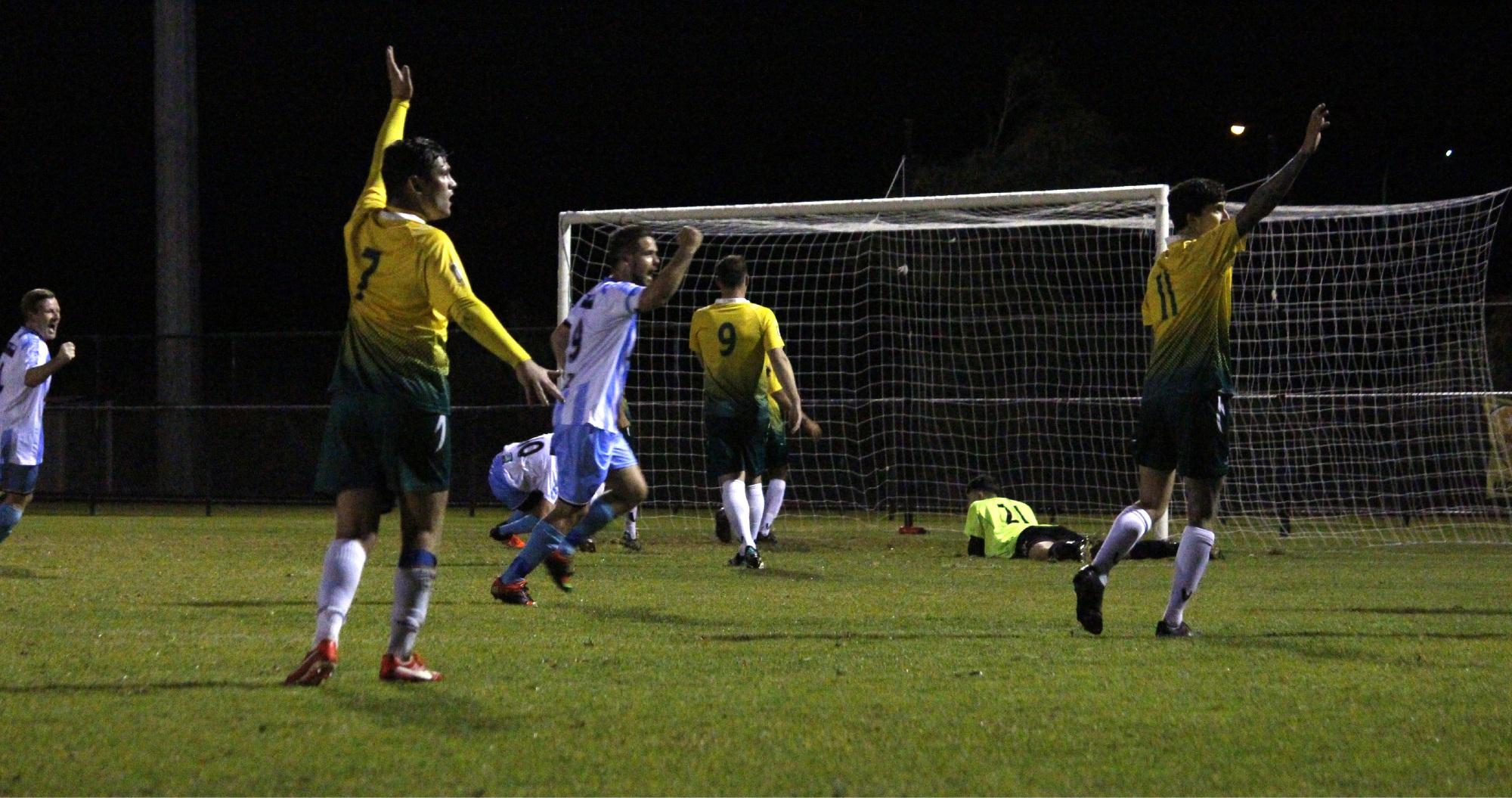 Rockingham City players appeal for offside, but it is in vain as Jordan Rhodes nets Mandurah's winner. Picture: Declan Byrne