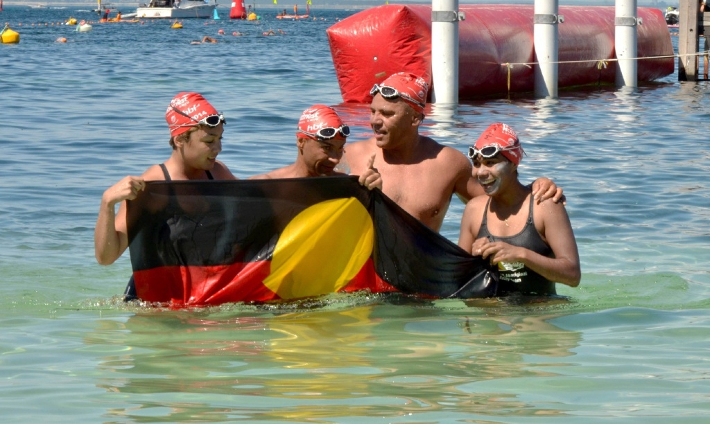 Vinka Barunga, Brendan Moore, Dennis Simmons and Brianna Ozies arrive at Rottnest Island after completing the Channel Swim.