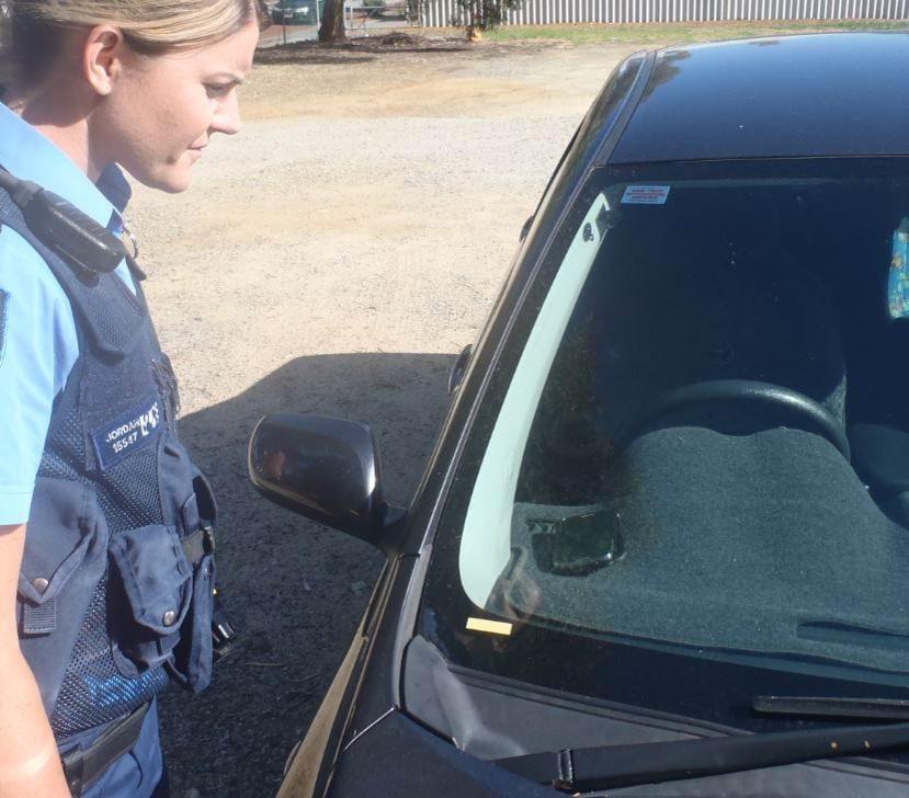 Constable Katie Jordan checks a car.