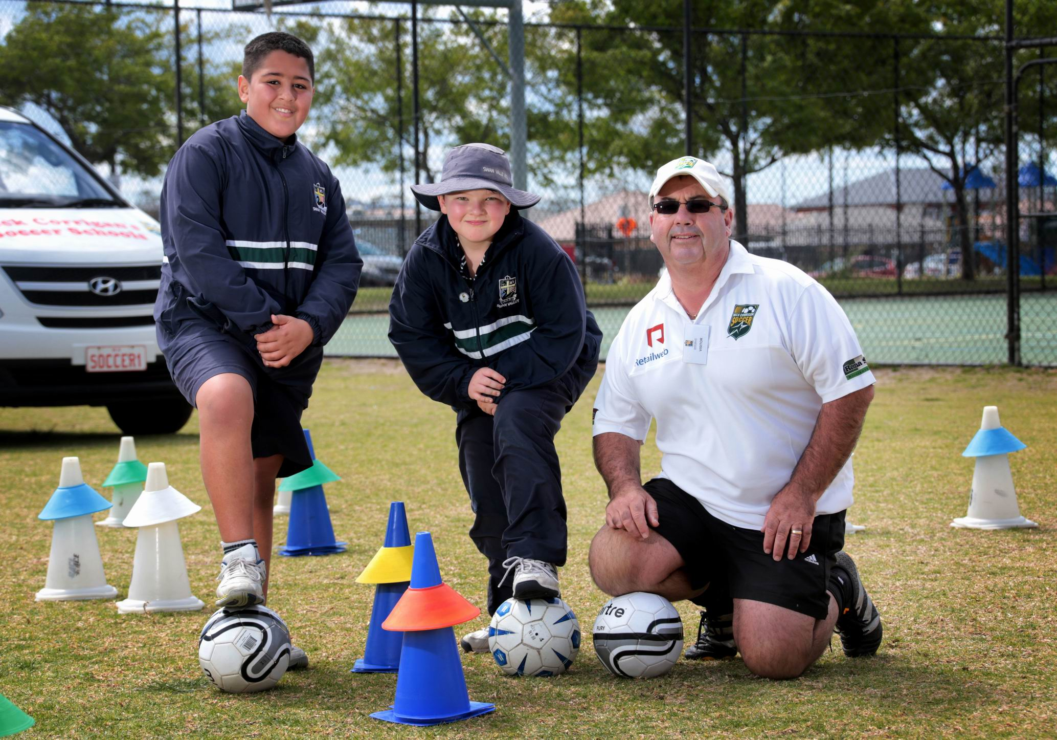 Emmanuel Bajada (10), Ace Geldert (9) and Nick Corrigan from the Nick Corrigan Soccer School. Picture: David Baylis