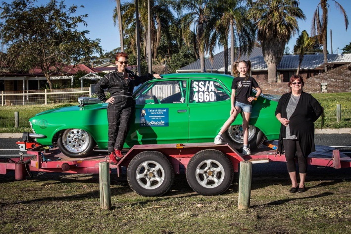 Andy Jahle with her drag car, Kidzucate co-founder Sian Williams (9) and festival organiser Toni Brown. Picture: Jack Foley