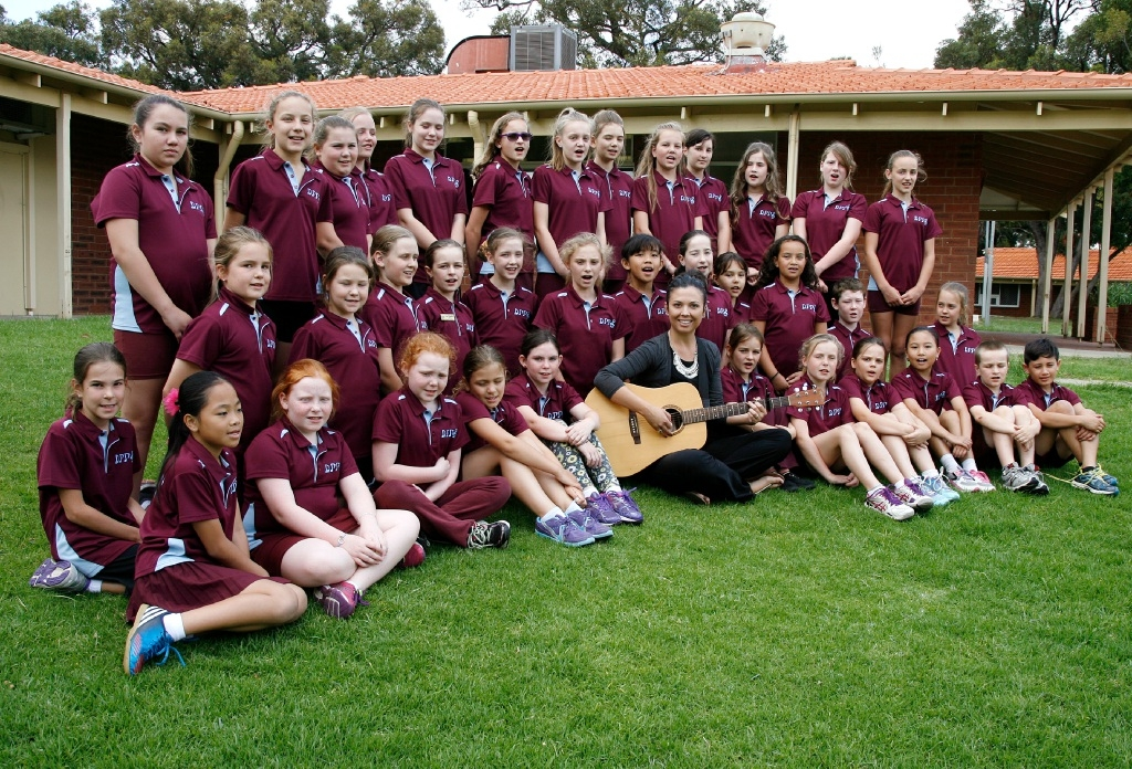 Dawson Park Primary School choir members and music teacher Kathryn Nelson.Picture: Marie Nirme        www.communitypix.com.au   d443155