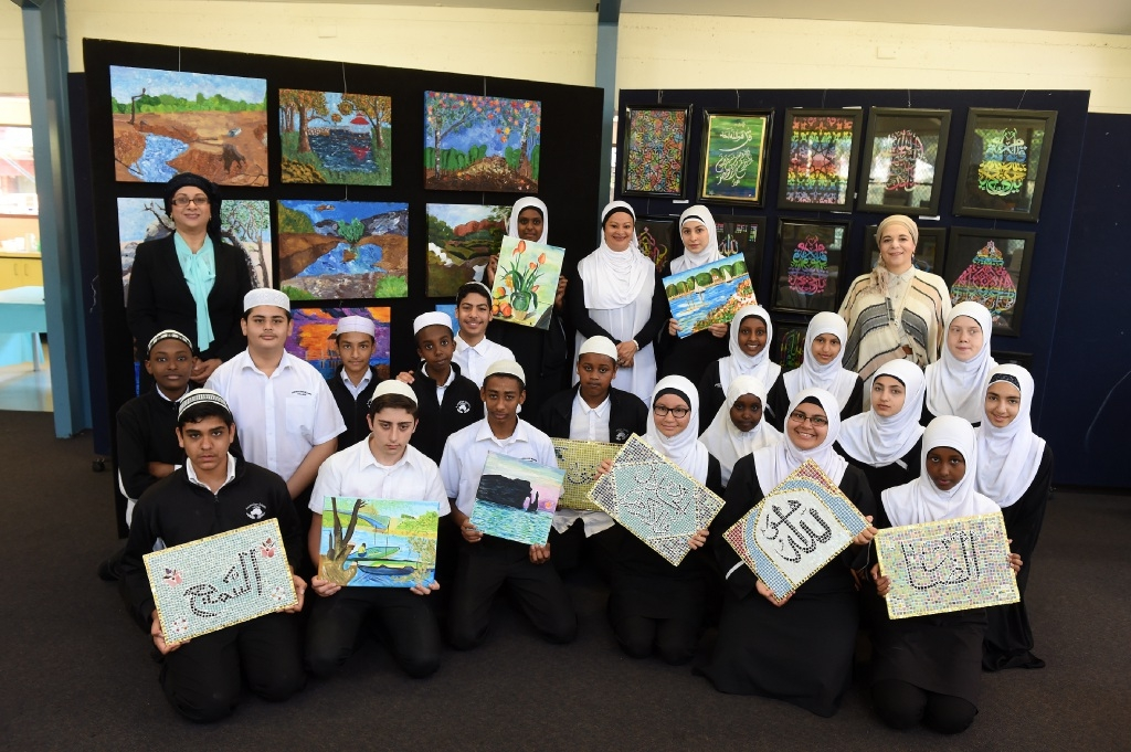 Art co-ordinator Amelia Joseph, principal Ahdielah Edries and art teacher Dina Magar with Year 8 and 10 students. Picture: Jon Hewson. Picture: Jon Hewson        www.communitypix.com.au   d445831