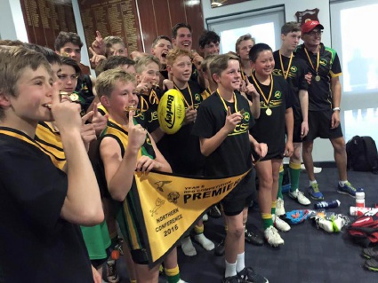 Year 8 Hornets players celebrate their grand final win.
