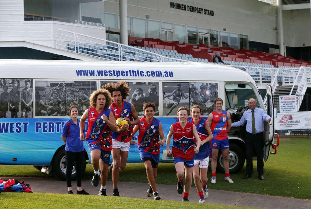 Joondalup Women's Football Team captain Ashton Hill, Djinda Falcons players Tyrell Nannup (14),Treak Nannup (16) and Jayden Levia (14), Cooper O'Brien (14) and Harry Quale (14) from West Perth's development squad, West Perth captain Jay van Berlo and Moore MP Ian Goodenough with the club's bus.  Picture: Martin Kennealey  www.communitypix.com.au   d459120