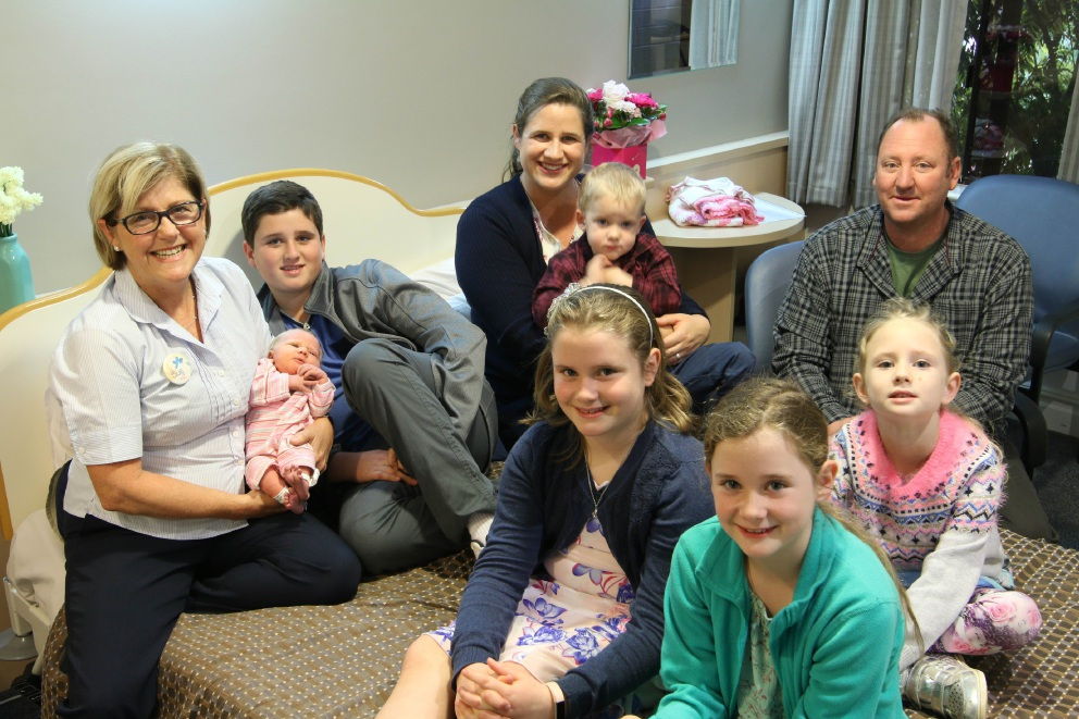 Glengarry Private Hospital midwife Sue Piccoli with Angeline and Chris Edmonds and children Evelyn (six weeks), Rowan (11), Alexander (2), Bonnie (10), Cassandra (7) and Josephine (6). Picture: Mal Beale.